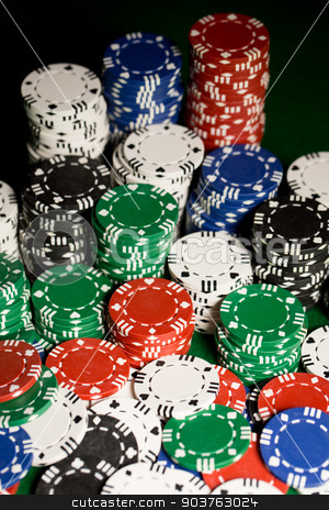 close up of casino chips on green table surface stock photo, gambling, fortune, game and entertainment concept - close up of casino chips on green table surface by Syda Productions