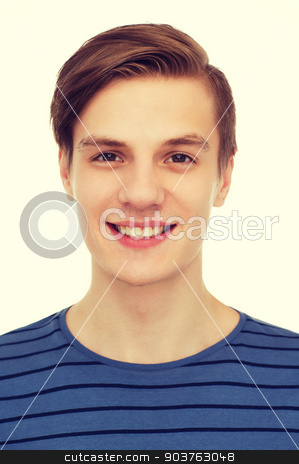 smiling teenage boy stock photo, people and happiness concept - smiling teenage boy over white background by Syda Productions