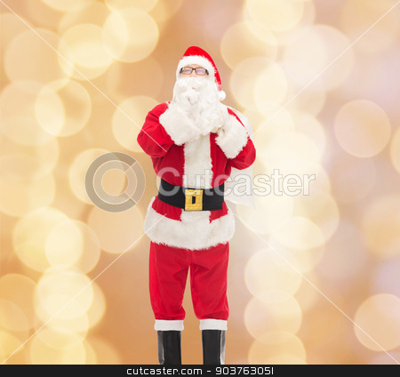 man in costume of santa claus with bag stock photo, christmas, holidays and people concept - man in costume of santa claus with bag making hush gesture over beige lights background by Syda Productions