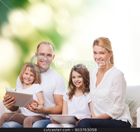 happy family with tablet pc computers stock photo, family, ecology, technology and people - smiling mother, father and little girls with tablet pc computers over green background by Syda Productions