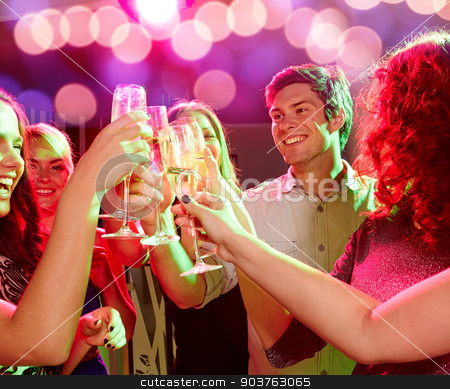smiling friends with glasses of champagne in club stock photo, party, holidays, celebration, nightlife and people concept - smiling friends clinking glasses of champagne in club by Syda Productions