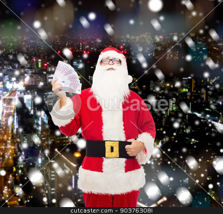 man in costume of santa claus with euro money stock photo, christmas, holidays, winning, currency and people concept - man in costume of santa claus with euro money over snowy night city background by Syda Productions