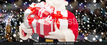 close up of santa claus with gift box stock photo, christmas, holidays and people concept - close up of santa claus with gift box over snowy night city background by Syda Productions