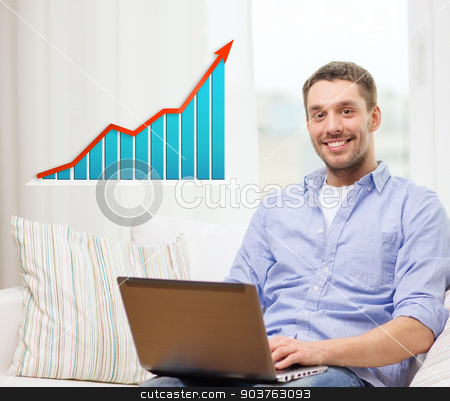 smiling man with laptop and growth chart at home stock photo, people, technology, statistics and business concept - smiling man with laptop computer and growth chart sitting on sofa at home by Syda Productions