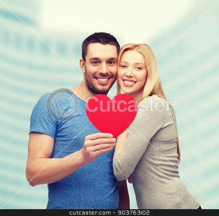 smiling couple holding big red heart stock photo, couple, love and family concept - smiling couple holding big red heart by Syda Productions