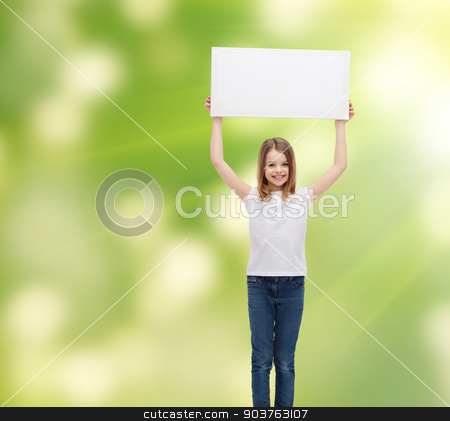 smiling little girl holding blank white board stock photo, advertisement, childhood, happiness and people concept - smiling little child in white t-shirt holding blank board over green background by Syda Productions