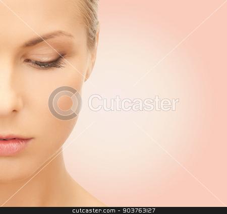 beautiful young woman half face stock photo, beauty, people and health concept - beautiful young woman face over pink background by Syda Productions