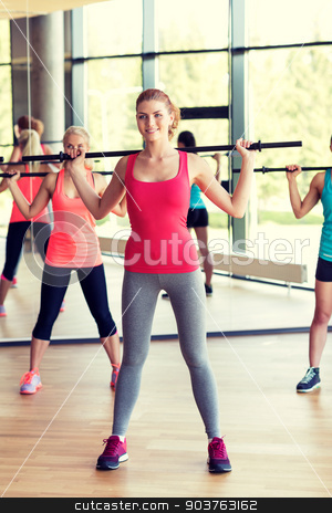 group of women with bars in gym stock photo, fitness, sport, training, gym and lifestyle concept - group of women with bars in gym by Syda Productions