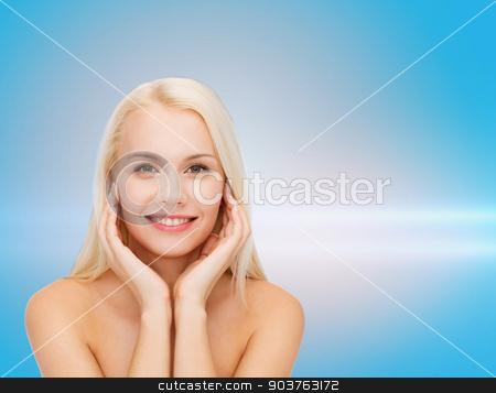 beautiful woman touching her face skin stock photo, health and beauty concept - beautiful woman touching her face skin by Syda Productions