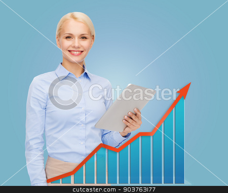 young smiling businesswoman with tablet pc stock photo, business, people, success, technology and statistics concept - young smiling businesswoman with tablet pc computer over blue background and growth chart by Syda Productions