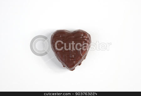 Chocolate Heart stock photo, A chocolated heart on a white background. by Scott Sanders
