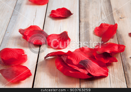 Rose Petals stock photo, Red rose petals on a wooden background. by Scott Sanders