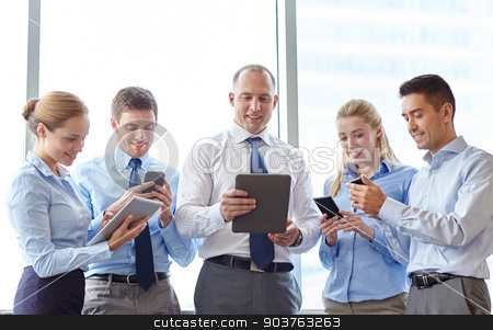 business people with tablet pc and smartphones stock photo, business, teamwork, people and technology concept - business team with tablet pc computers and smartphones meeting in office by Syda Productions