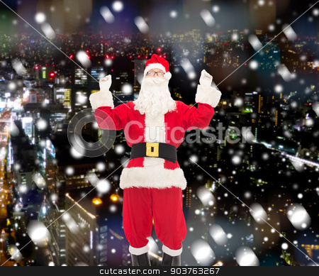 man in costume of santa claus stock photo, christmas, holidays and people concept - man in costume of santa claus having fun over snowy city background by Syda Productions