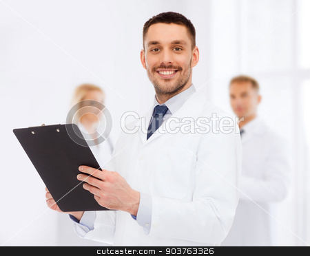 smiling male doctor with clipboard stock photo, medicine, profession, and healthcare concept - smiling male doctor with clipboard writing prescription over white background by Syda Productions