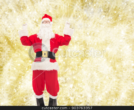 man in costume of santa claus stock photo, christmas, holidays and people concept - man in costume of santa claus having fun over yellow lights background by Syda Productions