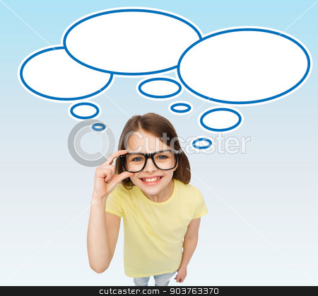 smiling girl in eyeglasses with blank text bubbles stock photo, education, school, people, childhood and vision concept - smiling cute little girl in black eyeglasses over blue background with white blank text bubbles by Syda Productions