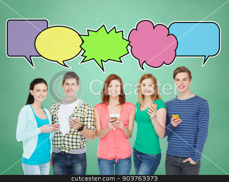 happy friends showing blank smartphones screens stock photo, people, communication, school and technology concept - smiling friends showing blank smartphones screens over blue background with doodles by Syda Productions