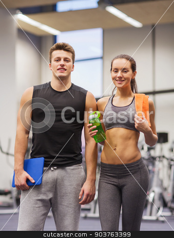 happy couple in gym with water and tablet pc stock photo, fitness, sport, people and lifestyle concept - happy couple in gym with water, towel and tablet pc computer by Syda Productions