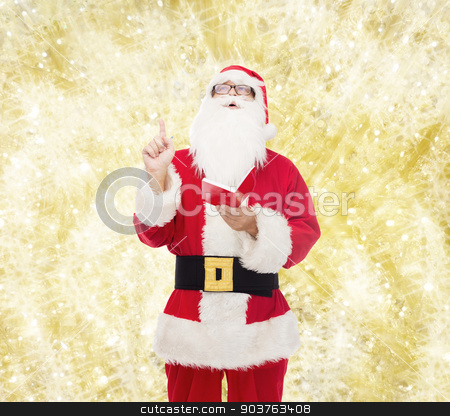 man in costume of santa claus with notepad stock photo, christmas, holidays, gesture and people concept - man in costume of santa claus with notepad pointing finger up over yellow lights background by Syda Productions