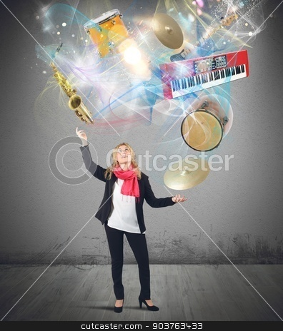 Music juggler stock photo, Woman plays with instruments like a juggler by Federico Caputo