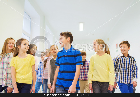 group of smiling school kids walking in corridor stock photo, education, elementary school, drinks, children and people concept - group of smiling school kids walking in corridor by Syda Productions