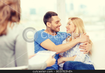 young couple hugging at psychologist office stock photo, love, family, phychology and happiness concept - young couple hugging at psychologist office by Syda Productions