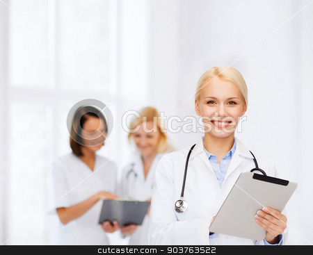 female doctor with stethoscope and tablet pc stock photo, healthcare, technology and medicine concept - smiling female doctor with stethoscope and tablet pc computer by Syda Productions
