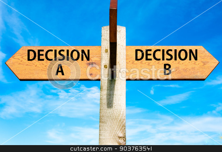 Wooden signpost with two opposite arrows over clear blue sky, Decision A and Decision B messages, Right choice conceptual image stock photo, Wooden signpost with two opposite arrows over clear blue sky, Decision A and Decision B messages, Right choice conceptual image by Constantin Stanciu
