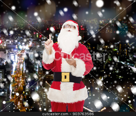 man in costume of santa claus with notepad stock photo, christmas, holidays, gesture and people concept - man in costume of santa claus with notepad pointing finger up over snowy night city background by Syda Productions