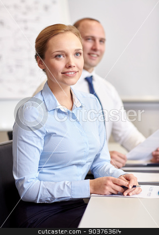 smiling business people meeting in office stock photo, business, people and technology concept - smiling business team with papers meeting in office by Syda Productions