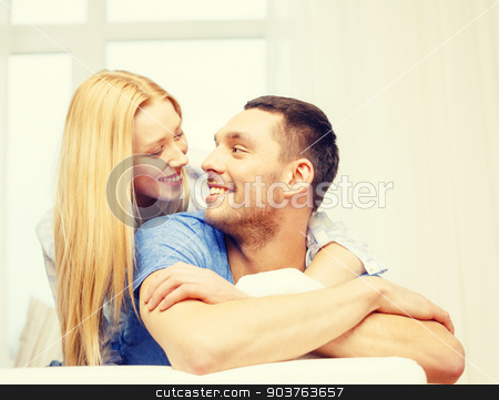 smiling happy couple at home stock photo, love, family and happiness concept - smiling happy couple at home by Syda Productions
