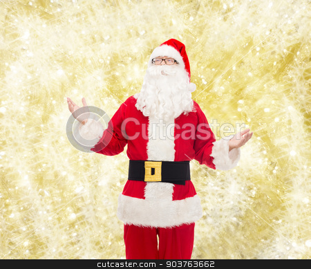 man in costume of santa claus stock photo, christmas, holidays and people concept - man in costume of santa claus over yellow lights background by Syda Productions