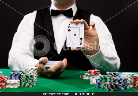holdem dealer with playing cards and casino chips stock photo, casino, gambling, poker, people and entertainment concept - close up of holdem dealer with playing cards and chips on green table by Syda Productions