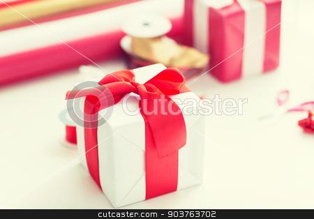 close up of christmas presents stock photo, holidays and celebration concept - close up of christmas presents, decoration paper, ribbons and scissors by Syda Productions