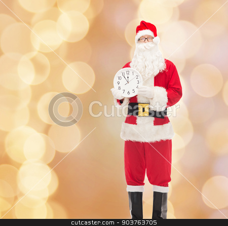 man in costume of santa claus with clock stock photo, christmas, holidays and people concept - man in costume of santa claus with clock showing twelve over beige lights background by Syda Productions