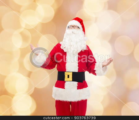 man in costume of santa claus stock photo, christmas, holidays and people concept - man in costume of santa claus over beige lights background by Syda Productions
