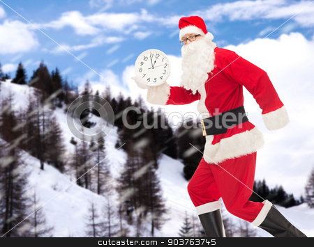 man in costume of santa claus with clock stock photo, christmas, holidays and people concept - man in costume of santa claus running with clock showing twelve over snowy mountains background by Syda Productions