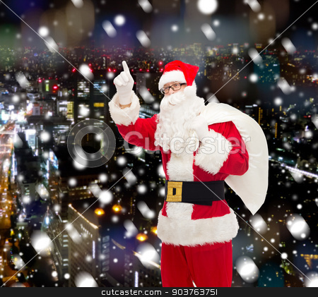 man in costume of santa claus with bag stock photo, christmas, holidays, gesture and people concept - man in costume of santa claus with bag pointing finger up over snowy night city background by Syda Productions