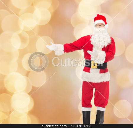 man in costume of santa claus stock photo, christmas, holidays, gesture and people concept - man in costume of santa claus over beige lights background by Syda Productions