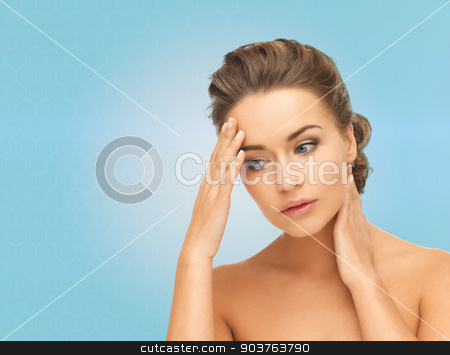 beautiful young woman touching her head and neck stock photo, beauty, people and health concept - beautiful young woman touching her head and neck over blue background by Syda Productions