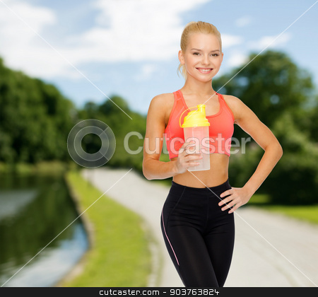 smiling sporty woman with protein shake bottle stock photo, sport, fitness and diet concept - smiling sporty woman with protein shake bottle by Syda Productions