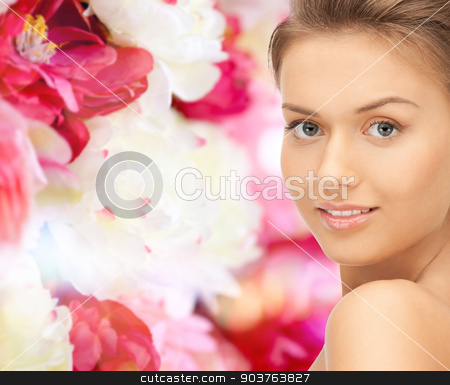 beautiful young woman with bare shoulders stock photo, beauty, people and health concept - beautiful young woman with bare shoulders over pink floral background by Syda Productions