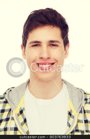smiling student boy stock photo, happiness, youth and people concept - smiling student boy by Syda Productions