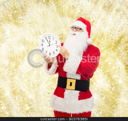 man in costume of santa claus with clock stock photo, christmas, holidays, time and people concept - man in costume of santa claus with clock showing twelve pointing finger over yellow lights background by Syda Productions