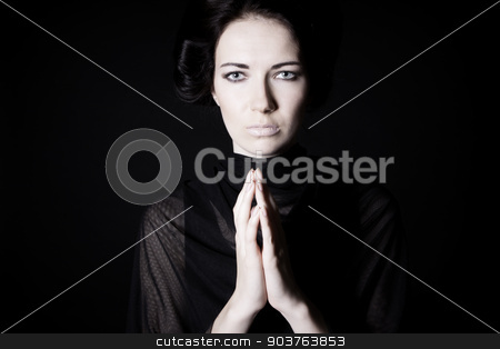 mourning stock photo, young beautiful girl praying. on a black background by Suchota