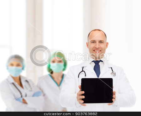 smiling male doctor with stethoscope and tablet pc stock photo, medicine, advertisement and teamwork concept - smiling male doctor with stethoscope showing tablet pc computer screen over group of medics by Syda Productions