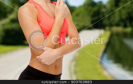sporty woman with pain in elbow stock photo, healthcare, fitness and medicine concept - sporty woman with pain in elbow by Syda Productions