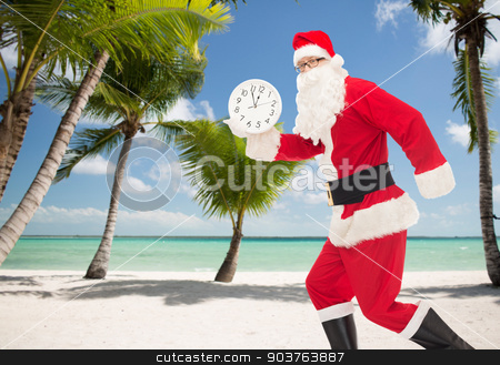 man in costume of santa claus with clock stock photo, christmas, holidays and people concept - man in costume of santa claus running with clock showing twelve over tropical beach background by Syda Productions