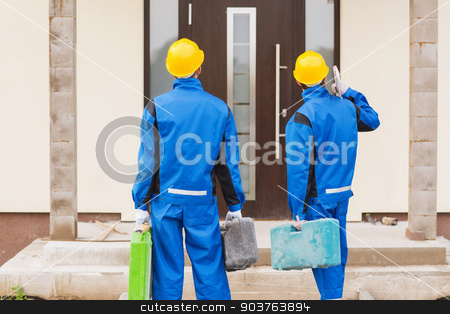 group of builders with toolboxes stock photo, business, building, teamwork and people concept - group of builders in hardhats with toolboxes outdoors from back by Syda Productions